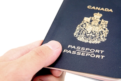 hand hold a isolated canadian passport